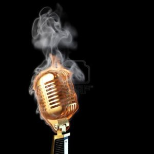 9094264-burning-old-golden-microphone-isolated-on-black